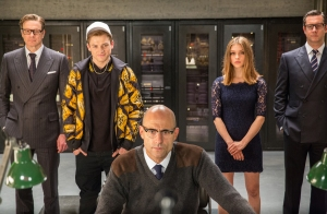 KSS_JB_D11_01354 - (From left) Harry (Colin Firth), Eggsy (Taron Egerton), Merlin (Mark Strong), Roxy (Sophie Cookson) and Percival (Alastair Macintosh) display varying reactions to an extraordinary event at the Kingsmen training facility.